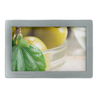 Green pickled pitted olives closeup rectangular belt buckles