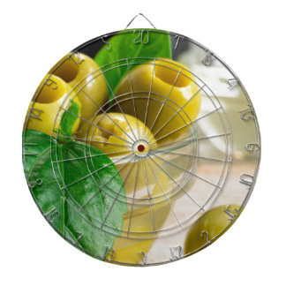 Green pickled pitted olives in a glass bowl dartboard