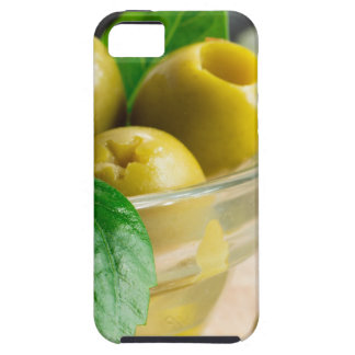 Green pickled pitted olives in a glass bowl iPhone 5 cases