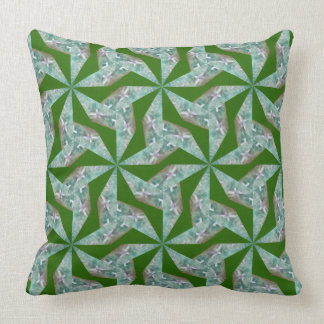 Green pillow with abstract geometric pattern