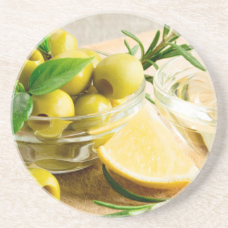 Green pitted olives decorated with herbs coaster