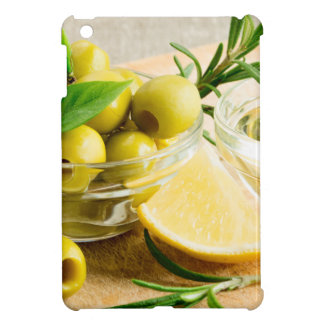 Green pitted olives decorated with herbs cover for the iPad mini
