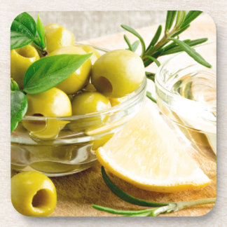 Green pitted olives decorated with herbs drink coasters