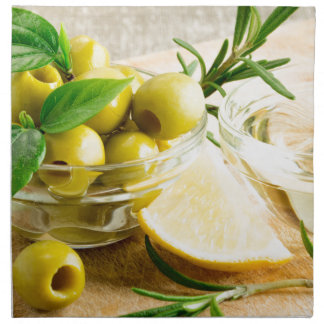 Green pitted olives decorated with herbs napkin