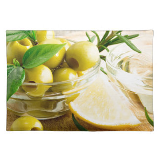 Green pitted olives decorated with herbs placemats