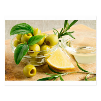 Green pitted olives decorated with herbs postcard