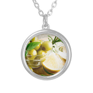 Green pitted olives decorated with herbs silver plated necklace