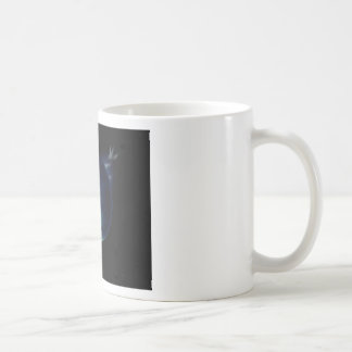 green planet in the universe with aura and stars coffee mug