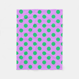 Green polka dots on lilac fleece blanket