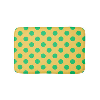 Green polka dots on yellow bath mat