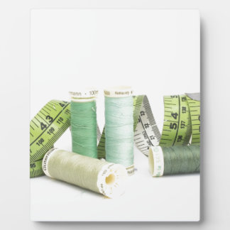 Green sewing kit and threads plaque