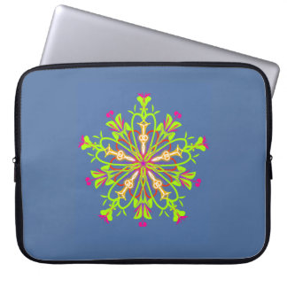 Green starflower mandala on calming blue laptop sleeve