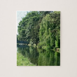 Green sunny spring day green trees river walk jigsaw puzzle