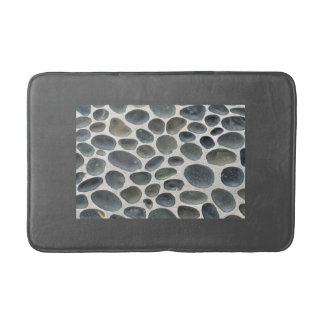 Grey bathmat with pebble patterned inset