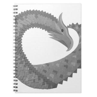 Grey heart dragon on white notebooks