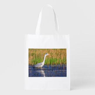 Grey heron, ardea cinerea, in a pond reusable grocery bag