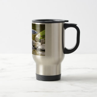 Grey heron on rock travel mug