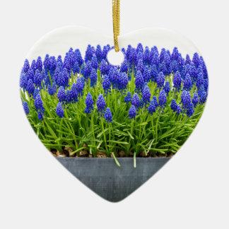 Grey metal flower box with blue grape hyacinths ceramic ornament