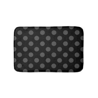 Grey polka dots on black bathroom mat
