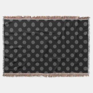 Grey polka dots on black throw blanket
