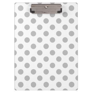 Grey polka dots on white clipboard