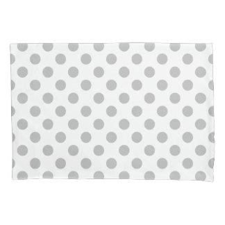 Grey polka dots on white pillowcase