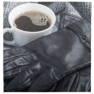 Grey wool scarf and leather gloves napkin
