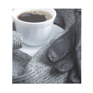 Grey wool scarf and leather gloves notepad