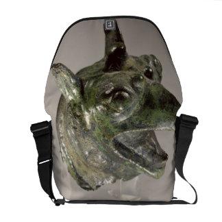 Griffin head, fragment of a cauldron attachment, f commuter bag