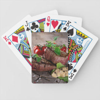 Grilled bbq steaks with fresh herbs and tomatoes bicycle playing cards
