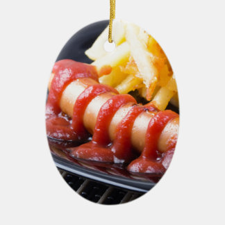 Grilled sausages and fried potato ceramic oval ornament