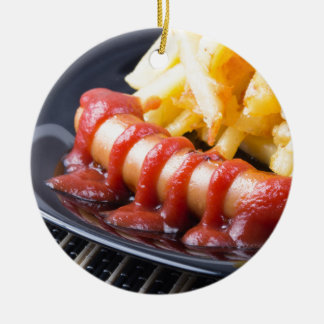 Grilled sausages and fried potato round ceramic ornament