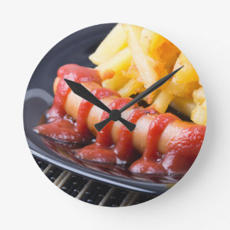 Grilled sausages and fried potato round clock
