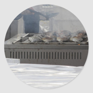 Grilling fish outdoors classic round sticker