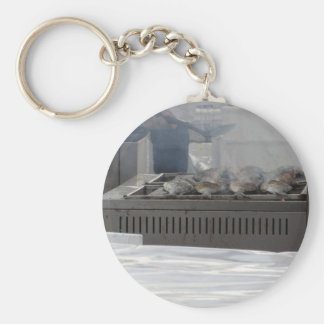 Grilling fish outdoors keychain