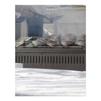 Grilling fish outdoors letterhead