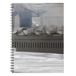 Grilling fish outdoors note book