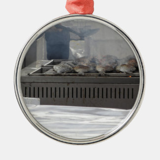 Grilling fish outdoors Silver-Colored round ornament