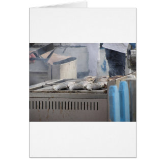 Grilling fish outdoors with smoke emerging card
