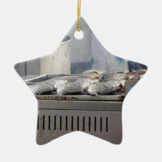 Grilling fish outdoors with smoke emerging ceramic ornament