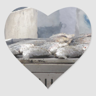 Grilling fish outdoors with smoke emerging heart sticker