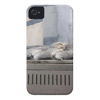 Grilling fish outdoors with smoke emerging iPhone 4 case