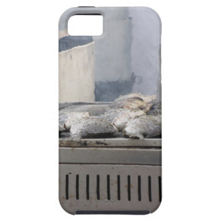Grilling fish outdoors with smoke emerging iPhone 5 cover