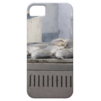 Grilling fish outdoors with smoke emerging iPhone 5 covers
