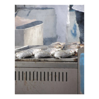 Grilling fish outdoors with smoke emerging letterhead