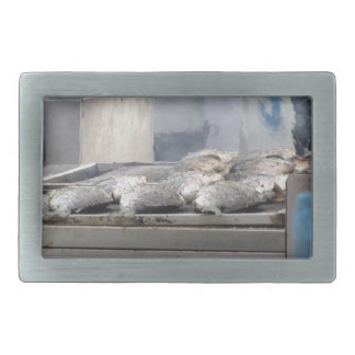 Grilling fish outdoors with smoke emerging rectangular belt buckle