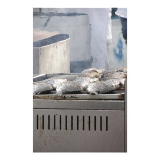Grilling fish outdoors with smoke emerging stationery