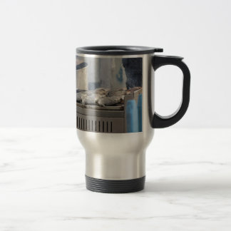 Grilling fish outdoors with smoke emerging travel mug