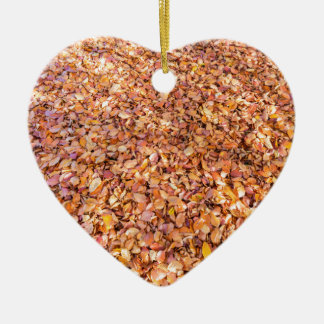 Ground covered with beech tree leaves in autumn ceramic heart ornament