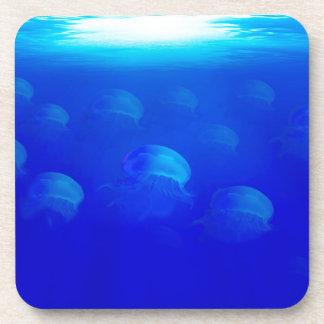 Group blue jellyfish in the Atlantic ocean swiming Coaster